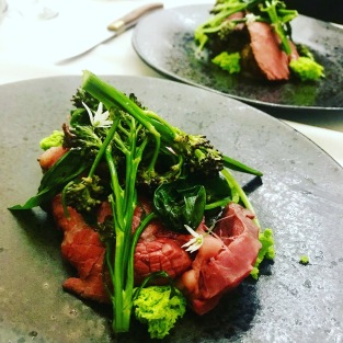 Galloway beef with sprouting brocoli, wild garlic leaves, flowers and sponge